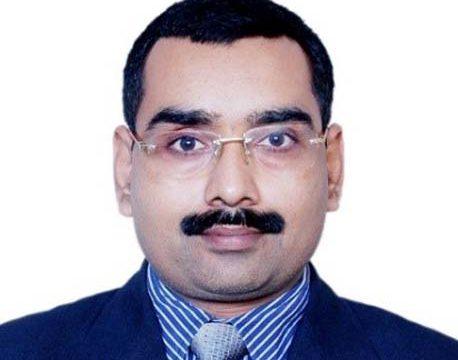 Dr. Anil M. Bisen